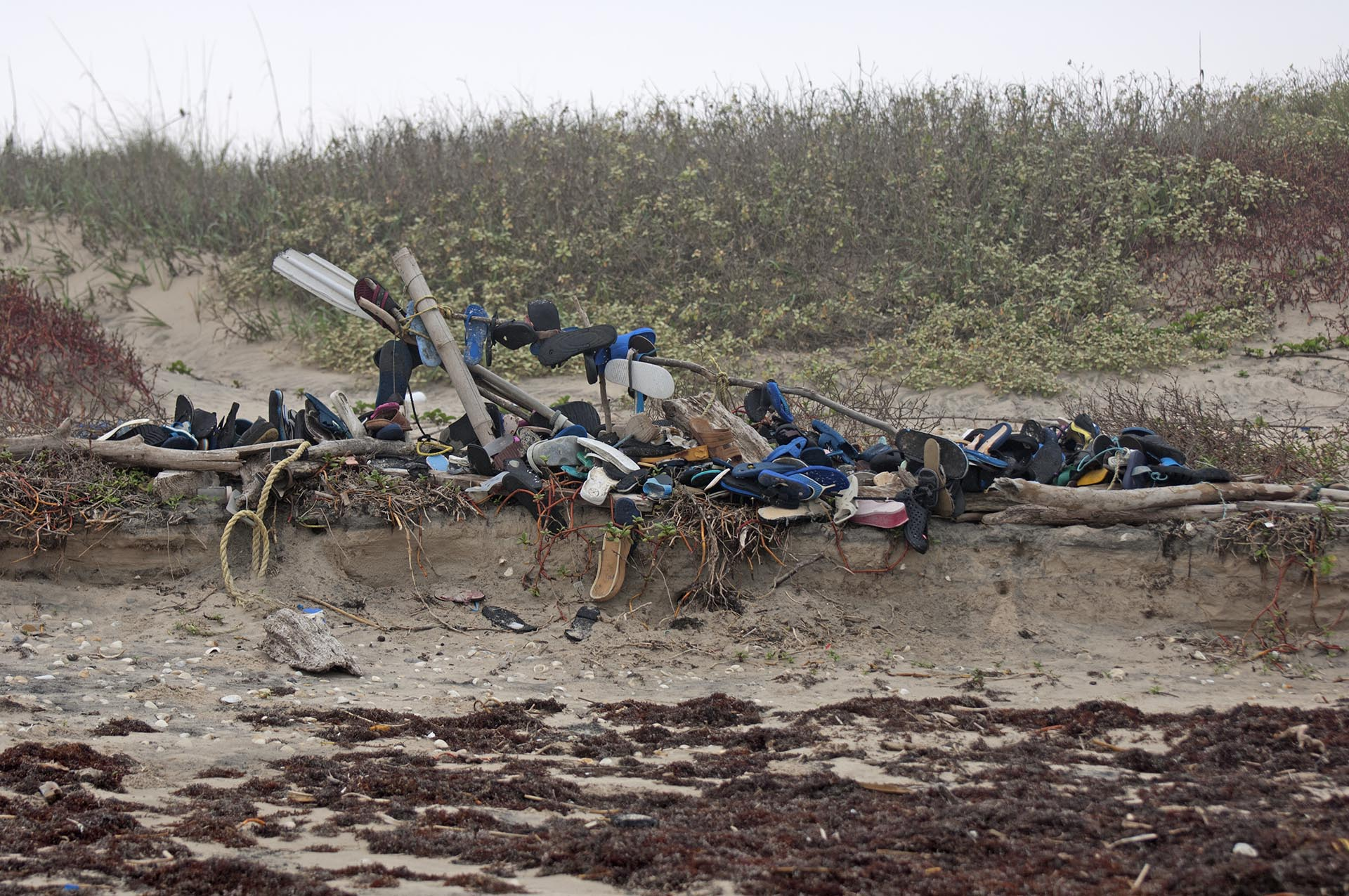 SPi beach sculpture flip flop tree destroyed by erosion
